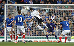 QOS's Nicky Clark scores with a header past Rangers keeper Neil Alexander