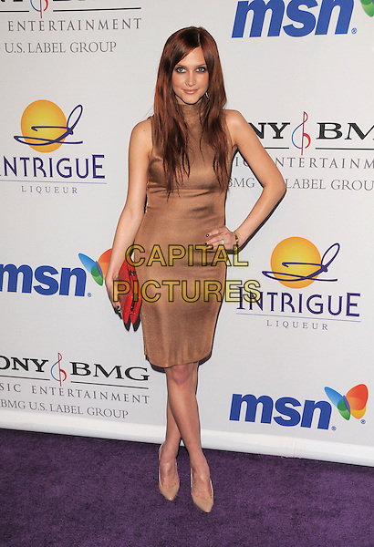 ASHLEE SIMPSON .The 2008 Clive Davis Pre-Grammy Party held at The Beverly Hilton Hotel in Beverly Hills, California on .February 9th, 2008          .full length beige brown bronze dress hand on hip red clutch bag purse sleeveless.CAP/DVS.©Debbie VanStory/Capital Pictures.