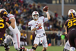 Wisconsin Badgers quarterback Alex Hornibrook (12) throws a touchdown pass during an NCAA College Big Ten Conference football game against the Minnesota Golden Gophers Saturday, November 25, 2017, in Minneapolis, Minnesota. The Badgers won 31-0. (Photo by David Stluka)