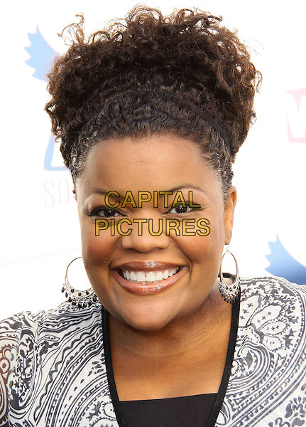 YVETTE NICOLE BROWN.2010 VH1 Do Something Awards held at the Hollywood Palladium, Hollywood, CA, USA..July 19th, 2010.headshot portrait black white silver hoop earrings smiling hair up  .CAP/ADM/TC.©T. Conrad/AdMedia/Capital Pictures.