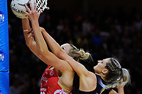 Jo Harten takes a rebound under pressure from Jane Watson during the Taini Jamieson Trophy Series netball match between the New Zealand Silver Ferns and England Roses at Te Rauparaha Arena in Porirua, New Zealand on Wednesday, 7 September 2017. Photo: Dave Lintott / lintottphoto.co.nz