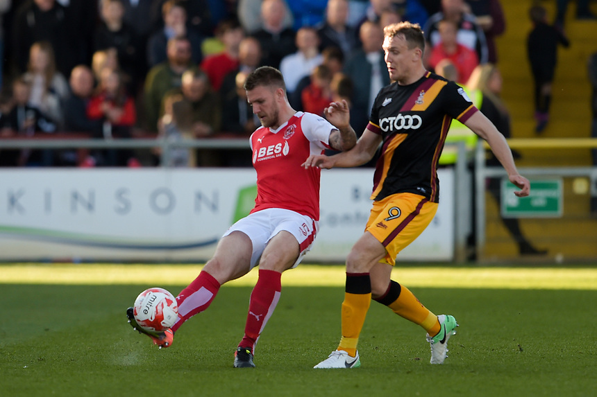 Fleetwood Town's Ashley Eastham under pressure from Bradford City's Charlie Wyke<br /> <br /> Photographer Terry Donnelly/CameraSport<br /> <br /> The EFL Sky Bet League One Play-Off Second Leg - Fleetwood Town v Bradford City - Sunday 7th May 2017 - Highbury Stadium - Fleetwood<br /> <br /> World Copyright &copy; 2017 CameraSport. All rights reserved. 43 Linden Ave. Countesthorpe. Leicester. England. LE8 5PG - Tel: +44 (0) 116 277 4147 - admin@camerasport.com - www.camerasport.com