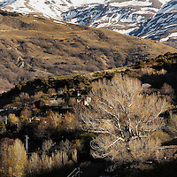 Landscape near Capileira, with snow-capped mountains in the background, Alpujarra, Sierra Nevada, Andalucia, Southern Spain. Photograph by Manuel Cohen.