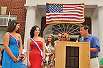 Winner of Miss Wantagh Pageant, Kara Arena, and 1st Runner Up, Shannon Dempsey, announced by Hempstead Town Clerk Mark Bonilla, at July 4th celebration in front of Wantagh High School, New York, 2011