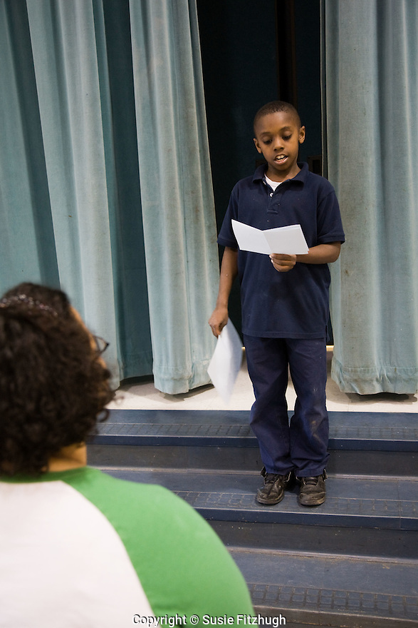 Amber Flame, a word artist whose source for inspiration finds its roots in the blues, works hard with Arts Corps students at Thurgood Marshall Elementary School to help her students find their own voices.