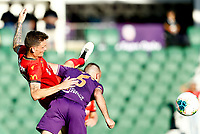 11th January 2020; HBF Park, Perth, Western Australia, Australia; A League Football, Perth Glory versus Adelaide United; Jordan Elsey from Adelaide United competes for the header with Ivan Franjic of the Perth Glory - Editorial Use