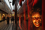 A wax figure in the window of Musee Grevin inside of Passage Jouffroy. Paris. France