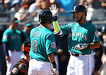 Seattle Mariners' Norichika Aoki greets Luis Sardinas at the plate after his 2-run homer in a spring training game against the SF Giants in Peoria, Ariz., on Wednesday, March 16, 2016. <br />
