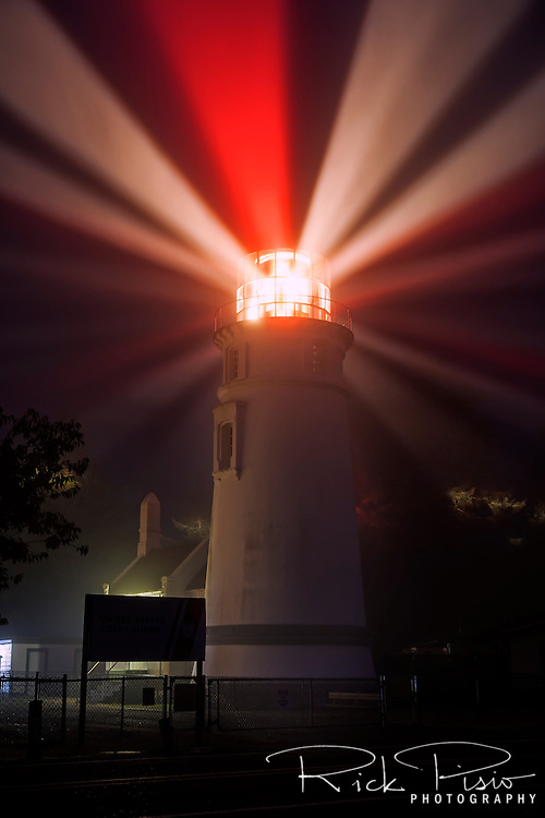 The Umpqua River Lighthouse at the entrance to Winchester Bay along the Oregon coast. The lamp was lit for the first time on December 31, 1894, with a signature of two white flashes followed by a red flash. <br />