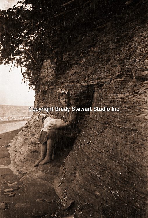 North East PA: Helen Stewart and Peppy watching the rain on Lake Erie - 1904. During the early 1900s, the Stewart family vacationed on Lake Erie near North East Pennsylvania. Since hotels and motels were non-existent, camping was the only viable option for a large number of vacationers