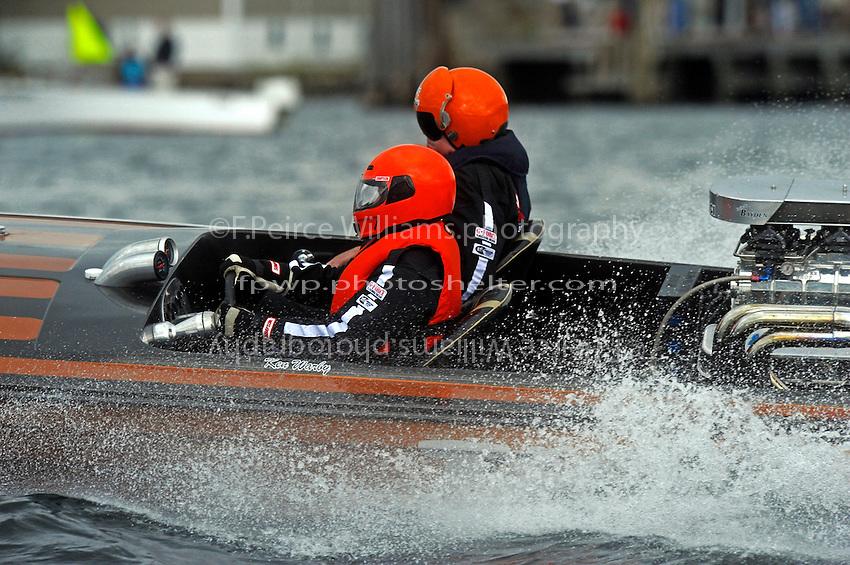 """Ken Warby, """"Tiger"""" (1976 Everingham racing flatbottom ski boat) Barbra Holmes driving."""