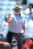 Home plate umpire Brandon Misun makes a call during a game between the Omaha Storm Chasers and Nashville Sounds on May 20, 2014 at Herschel Greer Stadium in Nashville, Tennessee.  Omaha defeated Nashville 4-1.  (Mike Janes/Four Seam Images)