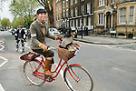 Tweed Run London woman with pet dog in shopping basket. Claudia Vogelgsang and Gunter.