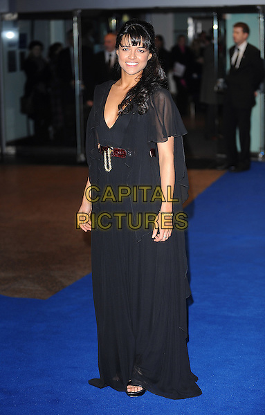 "MICHELLE RODRIGUEZ .Attending the World Premiere of ""Avatar"", Odeon Leicester Square, London, England, UK, .10th December 2009..full length black maxi dress belt v-neck floaty sleeve long maxi brown waist .CAP/BEL.©Tom Belcher/Capital Pictures."