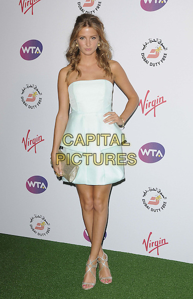 Millie Mackintosh.The WTA Pre-Wimbledon Party, The Roof Gardens, Kensington High St., London, England..June 21st, 2012.full length blue white strapless dress peplum hand on hip silver clutch bag.CAP/CAN.©Can Nguyen/Capital Pictures.