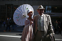 A couple pose for a picture as they take part during the annual easter parade in Manhattan, New York, 03.27.2016. This annual tradition has been taking place in New York City for over 100 years, Photo by VIEWpress.
