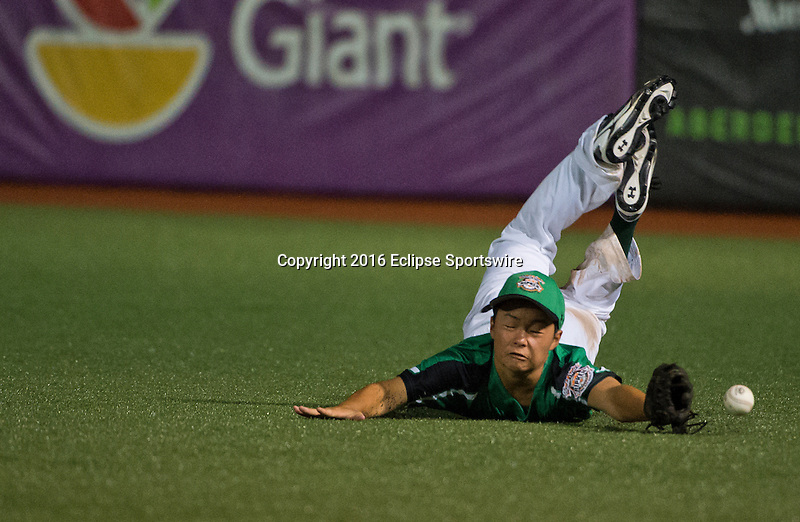 ABERDEEN, MD - AUGUST 01: Peyton Hino #11 of Honolulu (HI) just misses the diving catch during a game between Pacific Southwest and Maryland during the Cal Ripken World Series at The Ripken Experience Powered by Under Armour on August 1, 2016 in Aberdeen, Maryland. (Photo by Ripken Baseball/Eclipse Sportswire/Getty Images)