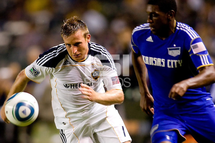 LA Galaxy midfielder Chris Birchall races towards the ball with Kansas City Wizard midfielder Craig Rocastle in chase. The Kansas City Wizards beat the LA Galaxy 2-0 at Home Depot Center stadium in Carson, California on Saturday August 28, 2010.