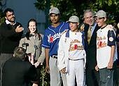 United States President George W. Bush poses for photographs with Venezuelan baseball players Tuesday, March 14, 2006, on the South Lawn of the White House. The players were guests at the arrival of Marine One after the President's trip to New York. The group is here on a State Department - funded International Sports Exchange centered around a shared passion of baseball and the inaugural World Baseball Classic.  <br /> Mandatory Credit: Eric Draper / White House via CNP