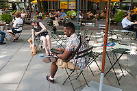 A park goers uses his iPad tablet computer in Bryant Park in New York on Friday, June 29, 2012 (© Richard B. Levine)