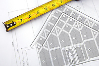 Detail photograph of a tape measure and drawings of a chapel under construction in Belmont, NC.