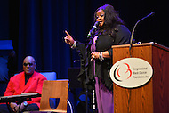 February 26, 2013  (Washington, DC)  Acclaimed singer Maysa speaks about Stevie Wonder (seated) at the historic Howard Theatre in D.C. (Photo by Don Baxter/Media Images International)