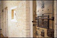 BNPS.co.uk (01202 558833)<br /> Pic: FrancisAmbler/Fine&amp;Country/BNPS<br /> <br /> Arrested development...<br /> <br /> A former magistrate's court and police station complete with original cells has been transformed into a quirky home - on the market for &pound;800,000.<br /> <br /> Although the building has had a makeover to a stylish home, the three cells for holding prisoners have been retained in their original form with one now serving as a study, another as a gym and the third as a utility room.<br /> <br /> The property was built in 1883 as part of Royston's police station and sergeant's house and also housed the magistrate's court for many years.