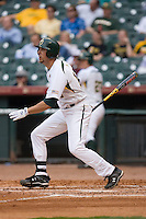 Dustin Dickerson #19 of the Baylor Bears follows through on his swing versus the Houston Cougars in the 2009 Houston College Classic at Minute Maid Park February 27, 2009 in Houston, TX.  The Bears defeated the Cougars 3-2. (Photo by Brian Westerholt / Four Seam Images)