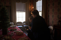 NWA Democrat-Gazette/CHARLIE KAIJO Malachi Cross, 8, of Springdale (center left) readies his plate for treats during the Washco Historical Society annual Holiday Open House, Sunday, December 2, 2018 at the Headquarters House in Fayetteville.<br /><br />Visitors enjoyed treats and drinks and carolers sang for neighbors of the Headquarters House.
