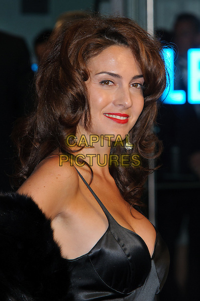 Lucia Siposova.'360' opening gala premiere, 55th BFI London Film Festival, Odeon cinema, Leicester Square, London, England..October 12th 2011.headshot portrait black red lipstick cleavage fur silk satin side.CAP/CJ.©Chris Joseph/Capital Pictures.