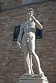 A replica of Michelangelo's David stands in front of the Palazzo della Signoria (also known as Palazzo Vecchio) in the Piazza della Signoria in Florence, Italy on Tuesday, October 22, 2013.  The original stood on this site from its completion in 1504 until it was moved to the Galleria dell'Accademia in 1873. <br /> Credit: Ron Sachs / CNP