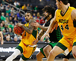 SIOUX FALLS, SD - MARCH 10: Vinnie Shahid #0 of the North Dakota State Bison drives on Marlon Stewart #1 the North Dakota Fighting Hawks during the men's championship game at the 2020 Summit League Basketball Tournament in Sioux Falls, SD. (Photo by Richard Carlson/Inertia)