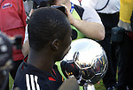 14 November 2004: Freddy Adu plants a kiss on the Alan I. Rothenberg Trophy. DC United defeated the Kansas City Wizards 3-2 to win MLS Cup 2004, Major League Soccer's championship game at the Home Depot Center in Carson, CA..
