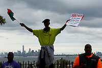 A man cheers others while thousands of People march against police brutality in Staten Island. 08.23.2014. Eduardo Munoz Alvarez/VIEWpress