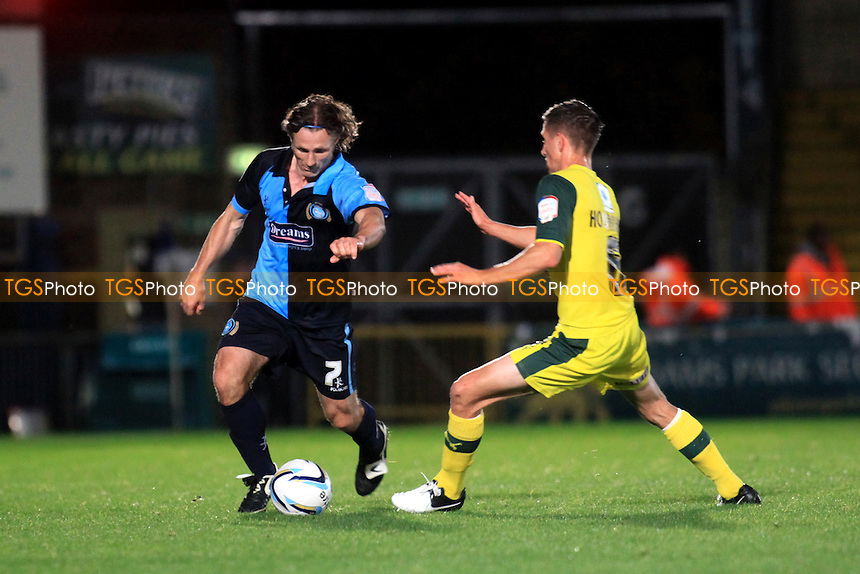 Wycombe Wanderers Caretaker Manager, Gareth Ainsworth takes the ball past Conor Hourihane of Plymouth Argyle - Wycombe Wanderers vs Plymouth Argyle - NPower League Two Football at Adams Park - 02/10/12 - MANDATORY CREDIT: Paul Dennis/TGSPHOTO - Self billing applies where appropriate - 0845 094 6026 - contact@tgsphoto.co.uk - NO UNPAID USE.