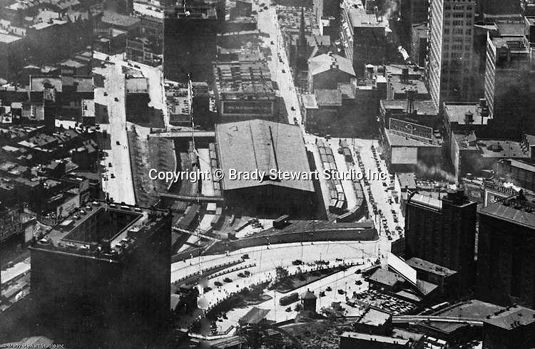 Pittsburgh PA:  Aerial view of Pittsburgh looking southwest over the Pennsylvania Railroad Station toward Grant Street - 1923.  The railroad terminal in the center of picture was leveled to enable the construction of the US Post Office Building and Courthouse.  They choose this area due to the rail service - the building was built over top of the railroad tracks.  The post office utilized the rail service for the delivery of mail.