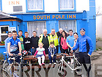 Celebrating the completion of their four-day cycle which began on March 13th at the North Pole Inn in Donegal and ended at The South Pole in Annascaul were back l- r Brendan Mulvihill,Steve Donegan, Shane O'Hanlon, John o Mahony, David Collins, Jim McCarthy,Tom O' Mahony, Pat Flavin, Jane Kearney, Mike Barry, Elaine Keane and William Keane. Front l-r Aoibhe Keane, Liam Keane and missing from photo Seamus Mulvihill.
