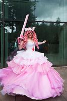 Beautiful Girl Twirling in Pink & White Flowing Ruffle Dress, Emerald City Comicon 2017, Seattle, WA, USA.