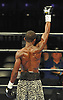Titus Williams, an Elmont native who made his professional debut, raises his arm in triumph after defeating opponent Micah Branch by unanimous decision in a Premier Boxing Champions match at the Barclays Center on Saturday, August 1, 2015. <br /> <br /> James Escher