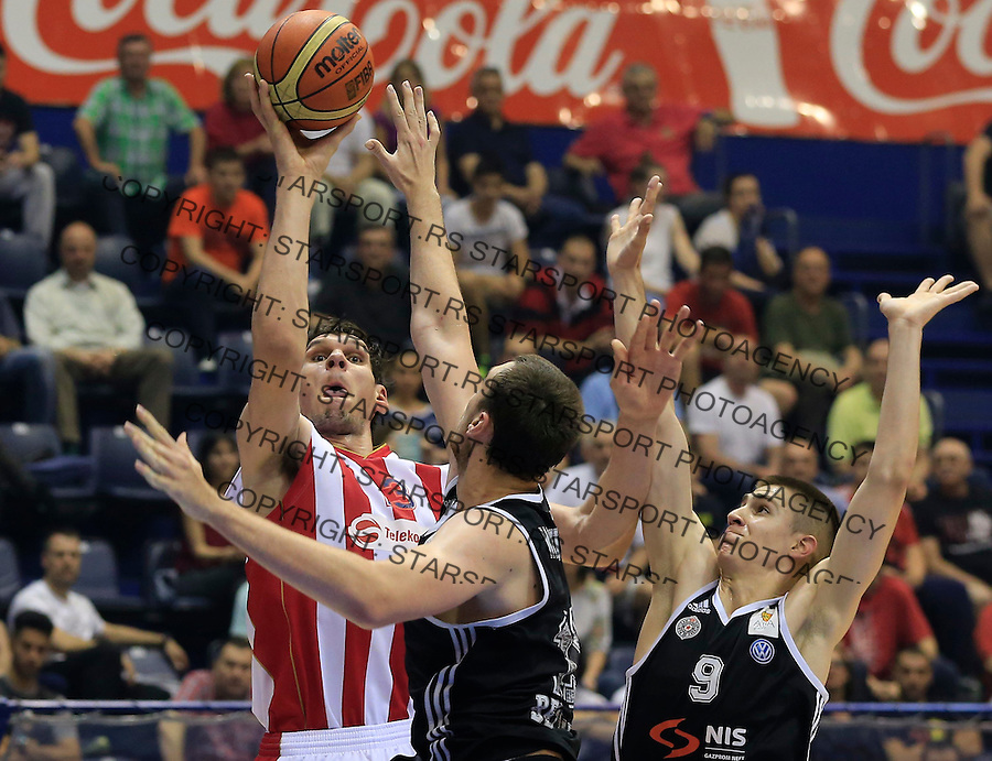 Kosarka Kosarkaska Liga Srbije season 2014-2015<br /> Crvena Zvezda v Partizan<br /> Boban Marjanovic (L) Nikola Milutinov (C) and Vanja Marinkovic<br /> Belgrade, 05.17.2015.<br /> foto: Srdjan Stevanovic/Starsportphoto &copy;