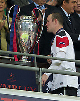 28.05.2011, Wembley Stadium, London, ENG, UEFA CHAMPIONSLEAGUE FINALE 2011, FC Barcelona (ESP) vs Manchester United (ENG), im Bild Manchester United's Wayne Rooney walks past the European Cup trophy looking utterly dejected as his side are outclassed by FC Barcelona 3-1 during the UEFA Champions League Final at Wembley Stadium, EXPA Pictures © 2011, PhotoCredit: EXPA/ Propaganda/ Chris Brunskill *** ATTENTION *** UK OUT! <br /> Foto Insidefoto