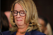 Professor Christine Blasey Ford, who has accused U.S. Supreme Court nominee Brett Kavanaugh of a sexual assault in 1982, gets emotional while testifying  before a Senate Judiciary Committee confirmation hearing for Kavanaugh on Capitol Hill in Washington, U.S., September 27, 2018. REUTERS/Jim Bourg