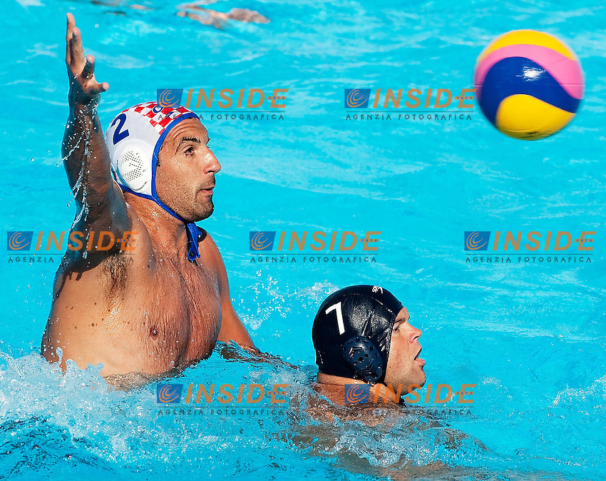 Roma 21th July 2009 - 13th Fina World Championships From 17th to 2nd August 2009..Water Polo Men..CRO 7 - 5 ROU....CROATIA..2 BURIC Damir....ROMANIA..7 DUNCA Gheorghe Florin....photo: Roma2009.com/InsideFoto/SeaSee.com