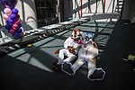 Furry Weekend Atlanta - Two furries sit together inside the Westin...Photo by Raymond McCrea Jones