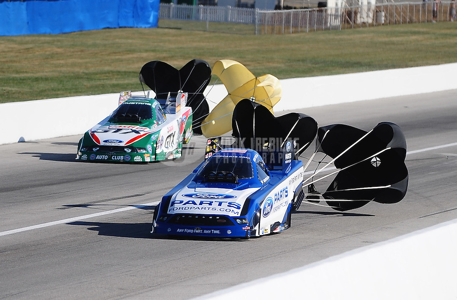 Sept. 5, 2010; Clermont, IN, USA; NHRA funny car driver Bob Tasca III (near) alongside John Force during qualifying for the U.S. Nationals at O'Reilly Raceway Park at Indianapolis. Mandatory Credit: Mark J. Rebilas-