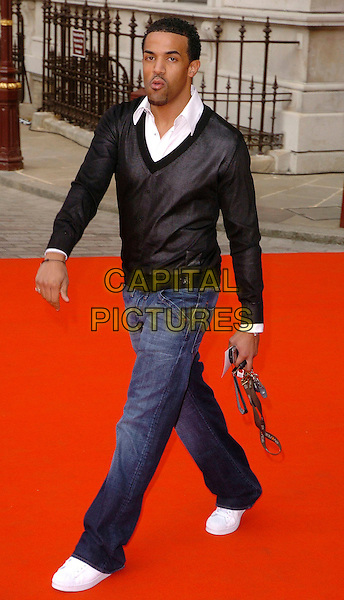 CRAIG DAVID.The 2006 Summer Exhibition Preview Party at the Royal Academy in Piccadilly, London, UK..June 7th, 2006 .Ref: CAV.full length black top cardigan jumper jeans denim.www.capitalpictures.com.sales@capitalpictures.com.© Capital Pictures.