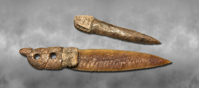 Brown obsidian dagger with a bone handle carved into the shape of a snake. It is believed this may have been a ritual dagger. Catalhoyuk Collections. Museum of Anatolian Civilisations, Ankara. Against a gray mottled background