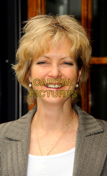 JENNY SEAGROVE.Photocall for PETA at Fortnum & Mason, urging them to 'Bring the final curtain down on fois gras', London,.England..May 5th, 2011.headshot portrait white beige brown herringbone.CAP/CJ.©Chris Joseph/Capital Pictures.