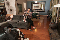 STAFF PHOTO ANTHONY REYES &bull; @NWATONYR<br /> Elizabeth Prenger, director of outreach for First Tee of NW Arkansas, with her dog Pippin, in her favorite space, her living room and dining room Monday, Sept. 22, 2014 at her home in Fayetteville. Prenger and her husband often entertain.