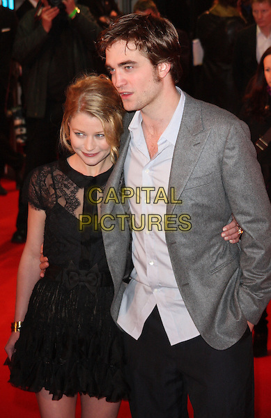 EMILIE DE RAVIN & ROBERT PATTINSON.UK Premiere of 'Remember Me' held at the Odeon Leicester Square, London, England..March 17th 2010.half length black lace dress sheer see through thru bows arm around grey gray jacket blazer blue shirt ruffle ruffles trousers rob .CAP/ROS.©Steve Ross/Capital Pictures.